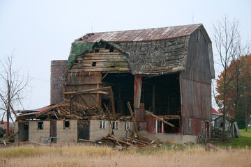 an old wrecked barn house falls apart