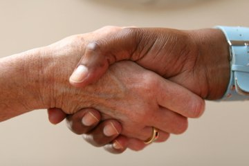two person shaking hands