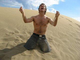 man without a shirt yelling