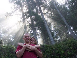happy couple on the forest with sun rays background