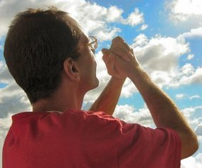 man praying passionately