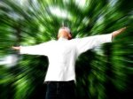 man raising both hands harnessing the power of the mind