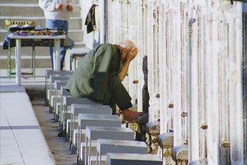 old man preparing for prayer