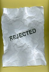 "crumpled paper with text ""REJECTED"""